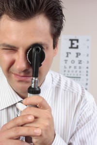 Eye doctor using opthalmoscope