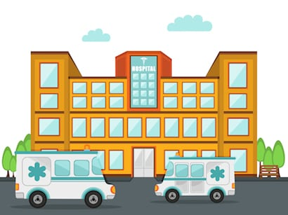 Front side view of a big hospital building with two ambulance standing outside.