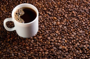 mug of coffee on a coffee beans background