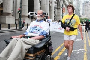 A man with ALS participates in a fundraiser for
