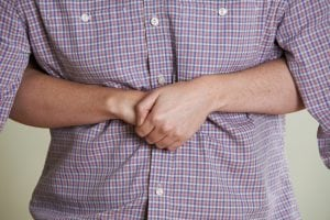 Close Up Of Woman Demonstrating Heimlich Maneuver