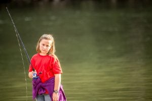 Little girl unhappy about losing a fish.