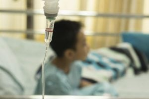 child receiving IV infusion