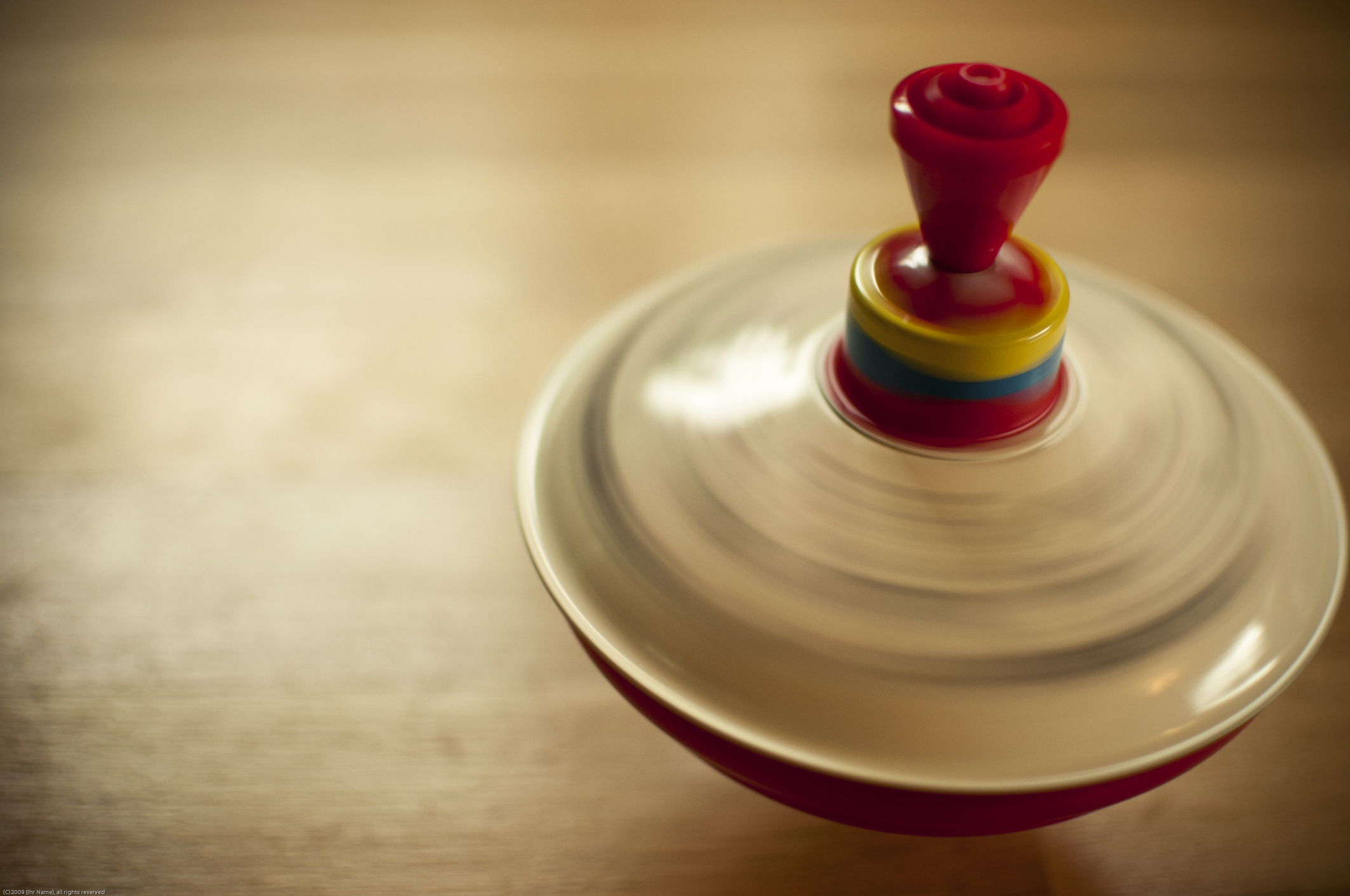 spinning top on the floor